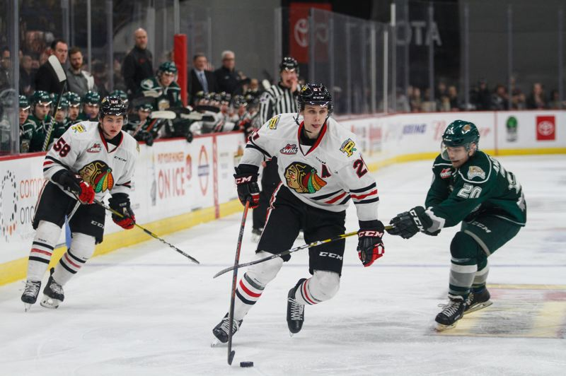 COURTESY: KEITH DWIGGINS/PORTLAND WINTERHAWKS - Brendan De Jong of the Portland Winterhawks carries the puck forward in a recent game. The fifth-year Hawks defenseman was drafted by NHL Carolina in 2017.