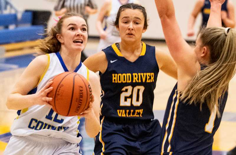 LON AUSTIN/CENTRAL OREGONIAN - Dallas Hutchins goes to the basket for two of her nine points in Crook County's Intermountain Conference victory over Hood River Valley.