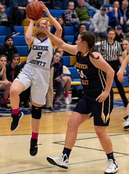LON AUSTIN/CENTRAL OREGONIAN - Teagan Freeman goes up for a shot during the Cowgirls' victory over the Hood River Valley Eagles. Freeman led Crook County in scoring with 10 points as the Cowgirls took a 41-39 victory.