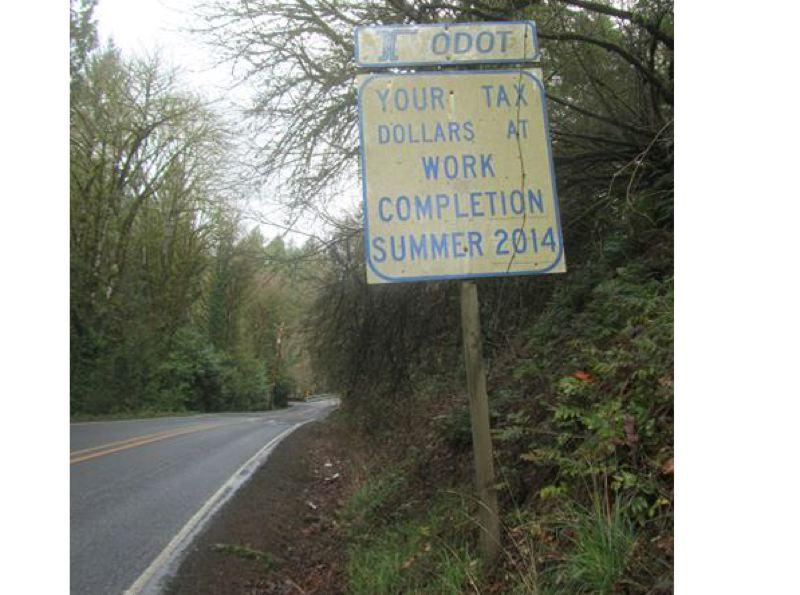 SUBMITTED PHOTO - Dan LaFave took this picture of an outdated sign along Springwater Road before it came down.