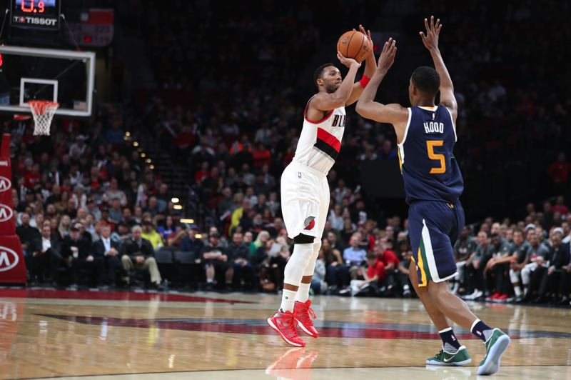 TRIBUNE FILE PHOTO: JAIME VALDEZ - Rodney Hood runs at Evan Turner of the Trail Blazers on a 3-point attempt. Hood has been traded from the Utah Jazz to Portland.
