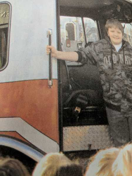 ARCHIVE PHOTO - Ten years ago, Clackamas River Elementary School student Trevor Cox rode to school in a fire engine.