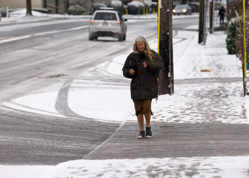 PAMPLIN MEDIA GROUP: JAIME VALDEZ - Walking near Southwest Capitol Highway was tricky for people Tuesday morning, Feb. 5.