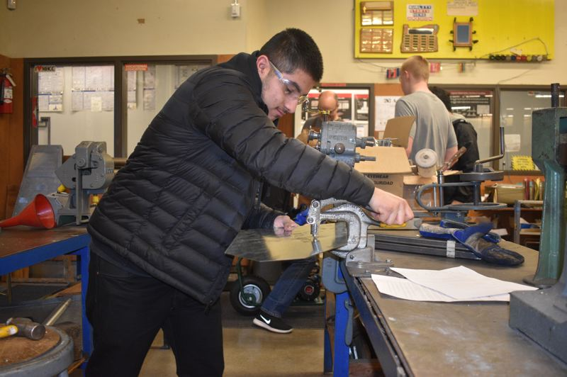 OUTLOOK PHOTO: TERESA CARSON - Reynolds High School senior Carols Garcia works on a project in the high schools new HVAC program, which was funded by Measure 98, passed by voters in 2016.