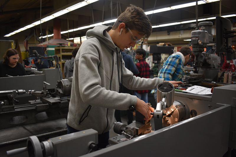 OUTLOOK PHOTO: TERESA CARSON - Centennial High School sophomore Nick Chub works on a new lathe paid for by Measure 98.