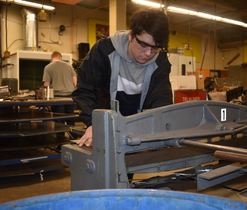 OUTLOOK PHOTO: TERESA CARSON - Reynolds senior Nicholas Blegen is in the new HVAC pre-apprentice program to get skills he hopes will be useful if he reaches his goal of becoming a firefighter.