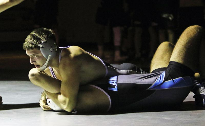 TIMES PHOTO: DAN BROOD - Tualatin High School junior Cody Van Meter (top) is about to pin Lakeridge senior Jonas Crowder during their 182-pound contest.