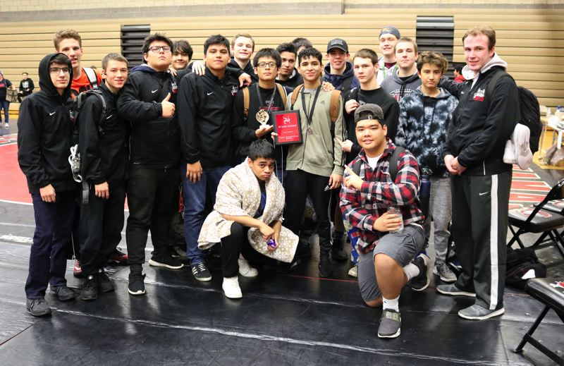 PMG PHOTO: JIM BESEDA - The Tualatin High School wrestling team took first place at the Bill Geister Invitational, held Friday and Saturday at Clackamas High School.