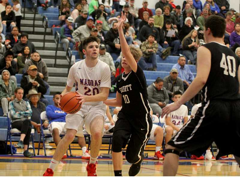 STEELE HAUGEN - Chapin Grote looks to make a pass during the Buffs' 79-54 win over Corbett Feb. 1.