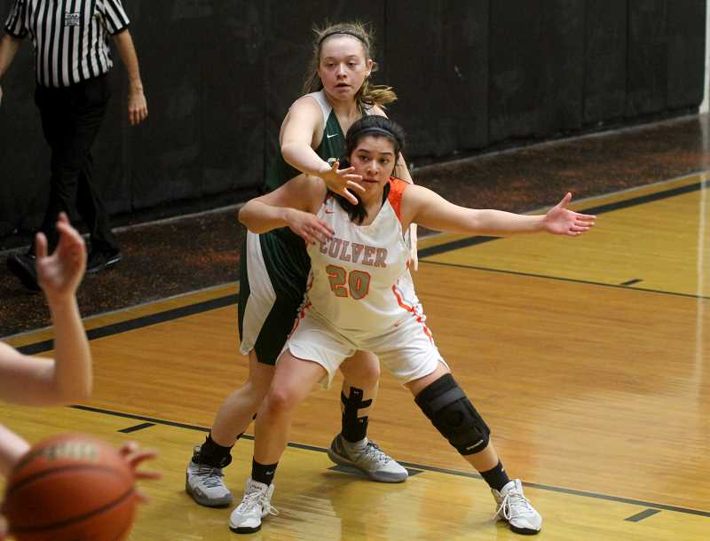 STEELE HAUGEN - Senior Nena Mendoza posts up a Colton player. The Lady Dawgs need to win their last two games of the season to make the playoffs.