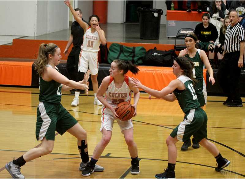 STEELE HAUGEN - Mikayla Haessler looks for an open player during Culver's 42-39 loss to Colton.
