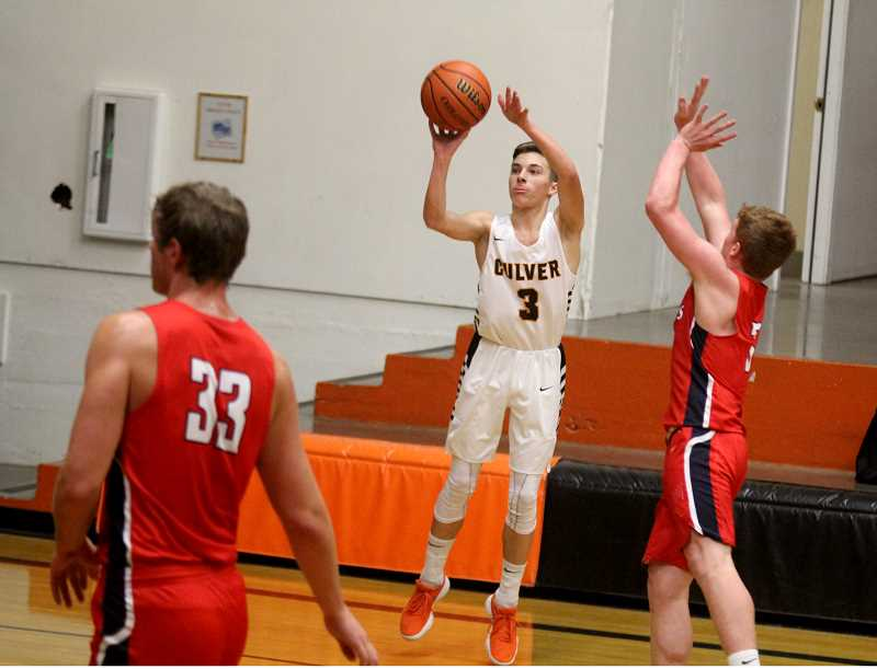 STEELE HAUGEN - Luke Spinelli takes a 3-point shot during the Bulldogs home game against Kennedy.