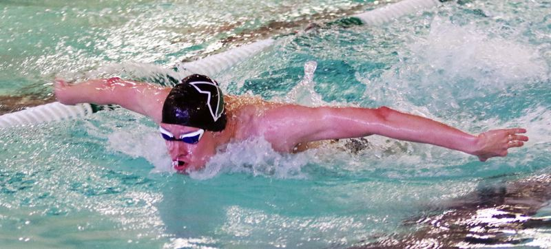 TIMES PHOTO: DAN BROOD - Tigard High School senior Ben Miller set a new Tigard Swim Center pool record with his winning time of 49.41 seconds in the 100-yard butterfly.
