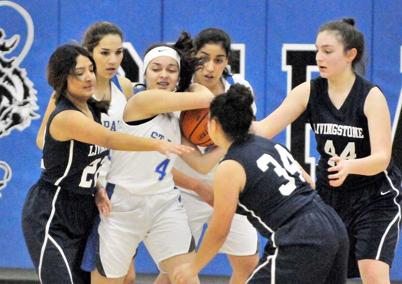 GARY ALLEN - Sophomore guard Mayra Paniagua Lozano protects the ball during the Bucks' blowout win over the Lions.