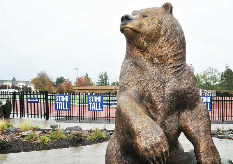 PHOTO BY: GARY ALLEN - Oak Grove's New Urban High School teacher and sculptor Ryan Wilhite spent two years crafting the 10-foot-tall, 800-pound Bruin sculpture recently installed at George Fox University.