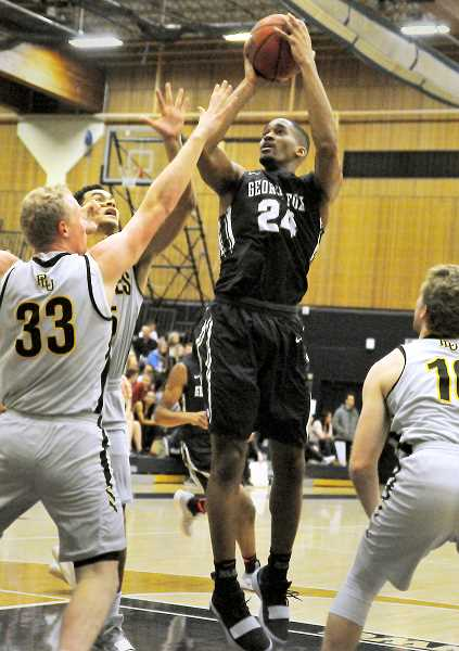 GARY ALLEN - Junior forward Wesley Reynolds finishes in traffic during the Bruins' loss to Pacific Lutheran on Saturday.