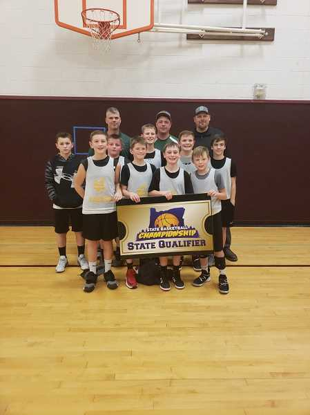 SUBMITTED PHOTO - The Colton Viking Youth Basketball sixth-grade tournamentbasketball team was invited to the state competition. They are (front row left to right): Wyatt Holliday, Jacob Bell, Henry Van Overen, Logan Roberts; (middle row) Riley Vance, Eli Pierce, Monty Robinson, Ben Imdieke, Cash Krall; (back row) Head Coach Jeremy Roberts, Coach Chris Imdieke, Coach Jeremy Pierce.