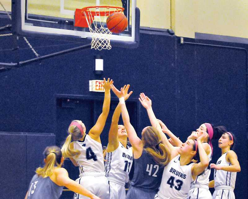 GARY ALLEN - The George Fox women crowded the paint in a dominant victory over Pacific Lutheran on Feb. 2.