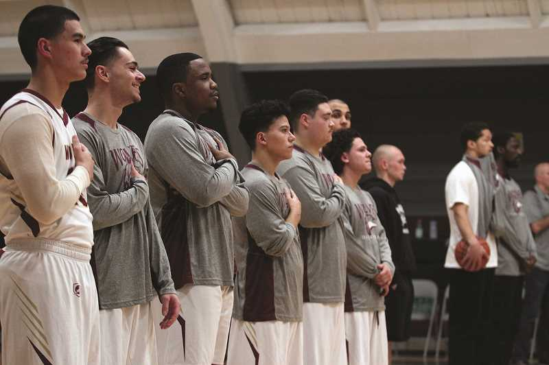 PMG PHOTO: PHIL HAWKINS - MacLaren youths (from left) Gavin B., Kristian M., DeVon B.H., Antonio L., Daniel R. and Alex V. line up for the national anthem in the Wolves final game of their 2018-19 high school basketball season.