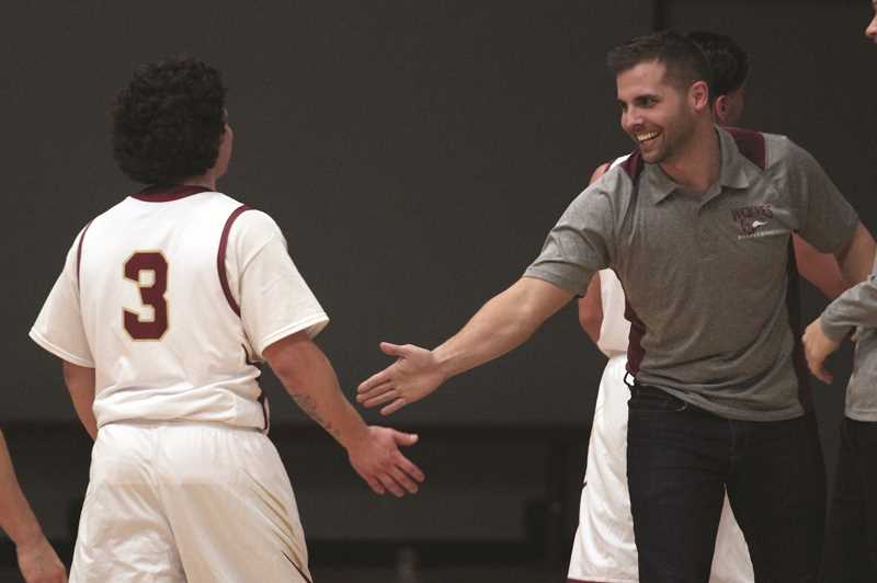 PMG PHOTO: PHIL HAWKINS - MacLaren head coach Tyler Allen congratulates Alex V. at the conclusion of the Wolves season finale against the Woodburn High School junior varsity team on Jan. 28.