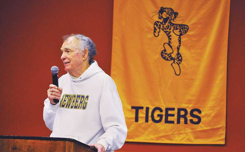 GARY ALLEN - Legendary Newberg High javelin coach Joe Boutin speaks at an event in his honor on Thursday.
