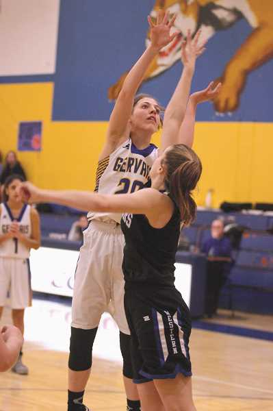 PMG PHOTO: PHIL HAWKINS - Gervais sophomore Katie Hansen goes up for a shot in the paint in the first half of the Cougars 45-36 loss to Western Christian on Friday.
