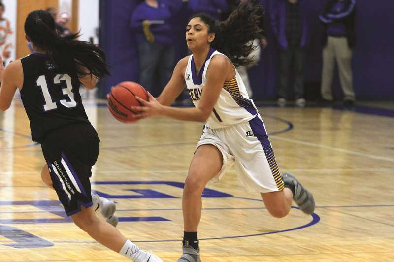 PMG PHOTO: PHIL HAWKINS - Gervais sophomore Araceli Vasquez picks off a Western Christian pass in the first half of the teams 45-36 loss to the Pioneers on Friday.