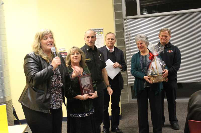 KRISTEN WOHLERS - Ginger Miller (second from left) receives the January CARE Award. Pictured from left to right are Knight Principal Christine Taylor, Miller, Canby Fire Battalion Chief Todd Gary, Superintendent Trip Goodall, Kiwanis's Marilyn Wood, and Fire Chief Jim Davis.