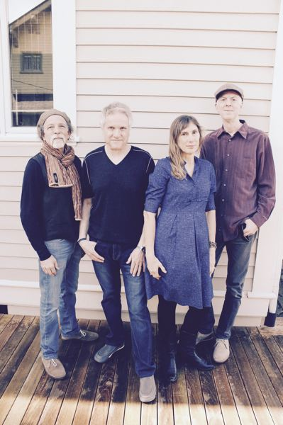 CONTRIBUTED PHOTO - JT Wise (second from left) worked in the studio with Portland bands that broke big in the early 1980s before concentrating on his own ensemble and raising a family with wife, Margaret (far right).