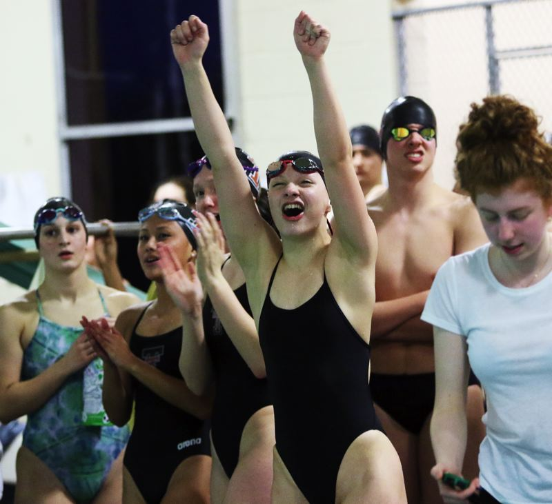 TIMES PHOTO: DAN BROOD - Tualatin junior Erika Farring cheers during the 400-yard freestyle event when the Wolves faced off with rival Tigard last week.