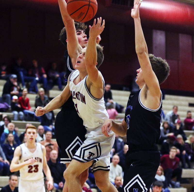 TIMES PHOTO: DAN BROOD - Tualatin senior Caden Dickson, shown here in a game earlier this season, scored 26 points to help the Wolves get a win at Lake Oswego on Friday.