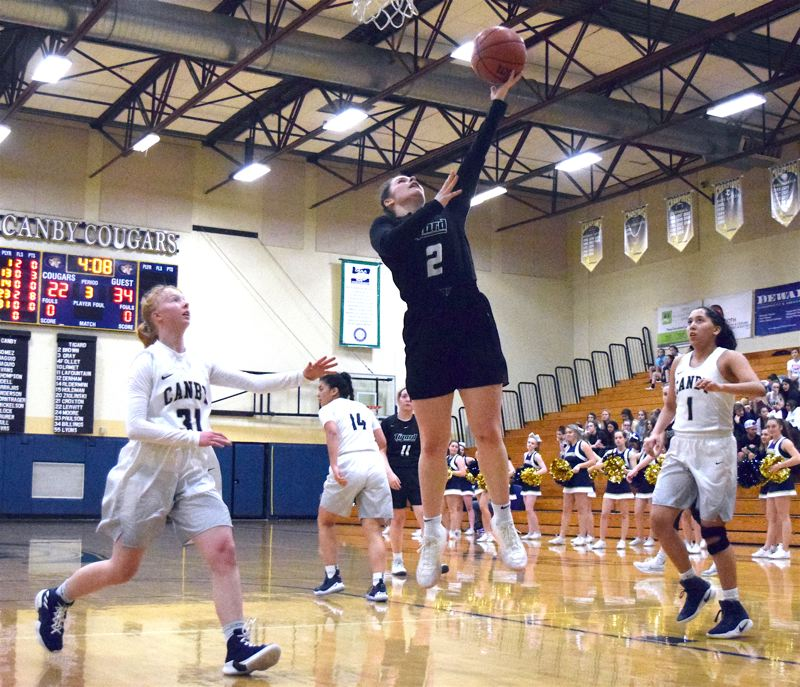 PMG PHOTO: TANNER RUSS - Tigard High School junior Kennedy Brown (2) goes up to the basket for the Tigers during their 50-39 win at Canby on Friday.