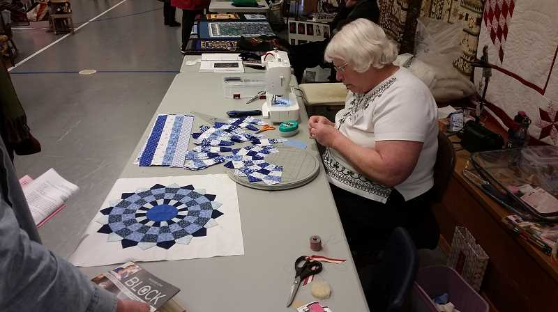 JOHN BAKER - Zion Mennonite's Quilting Workshop features finished quilts and plenty of hands-on demonstrations.
