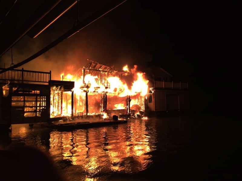PHOTO COURTESY OF SCAPPOOSE FIRE DISTRICT - A fire was reported at the Multnomah Channel Yacht Club  just before 6 p.m. on Tuesday, Feb. 5. The fire destroyed three homes and the cause of the blaze is still under investigation.