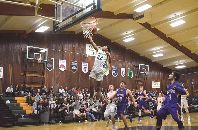 PIONEER PHOTO: TANNER RUSS - Colton senior Javontae Maes goes in for the layup against the Gervais defense.