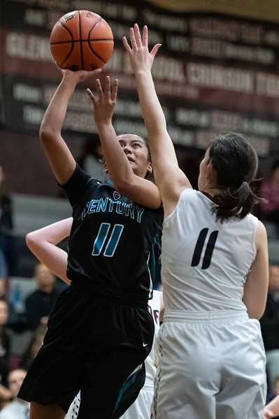 STAFF PHOTO: CHRISTOPHER OERTELL - Century's Janelle Maligaya goes up for a shot during the Jaguars' game against Glencoe Tuesday, Feb. 5, at Glencoe High School.