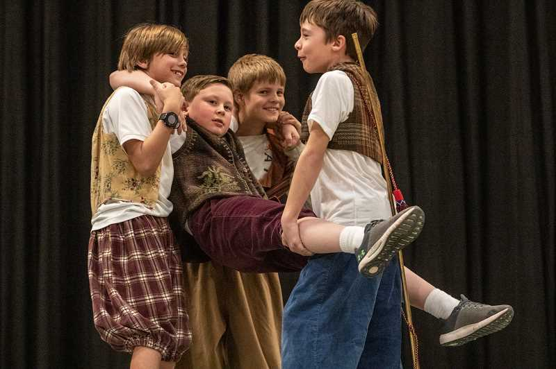 TIDINGS PHOTO: JONATHAN HOUSE - From left, Kellen Ostergard, Will Cadwell, Jacob Szok, and Ryan Weiler play giants in the upcoming production of Roald Dahl's 'World of Words.'