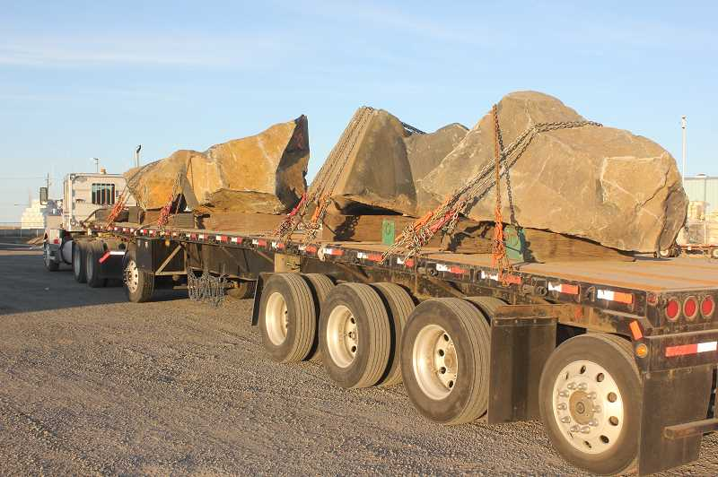 SUSAN MATHENY/MADRAS PIONEER - A shipment of boulders, from Central Oregon Basalt Products, is loaded onto a flatbed trailer. Each of the boulders weighs between 7 and 17 tons.