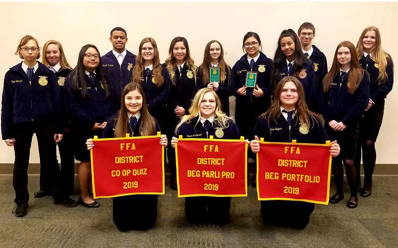SUBMITTED PHOTO - Madras FFA members show off their second-place banners from the Central Oregon District Leadership Career Development event.