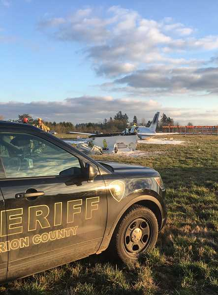 MARION COUNTY SHERIFF'S OFFICE  - A plane hit a radio antenna while preparing to land at Aurora Airport.