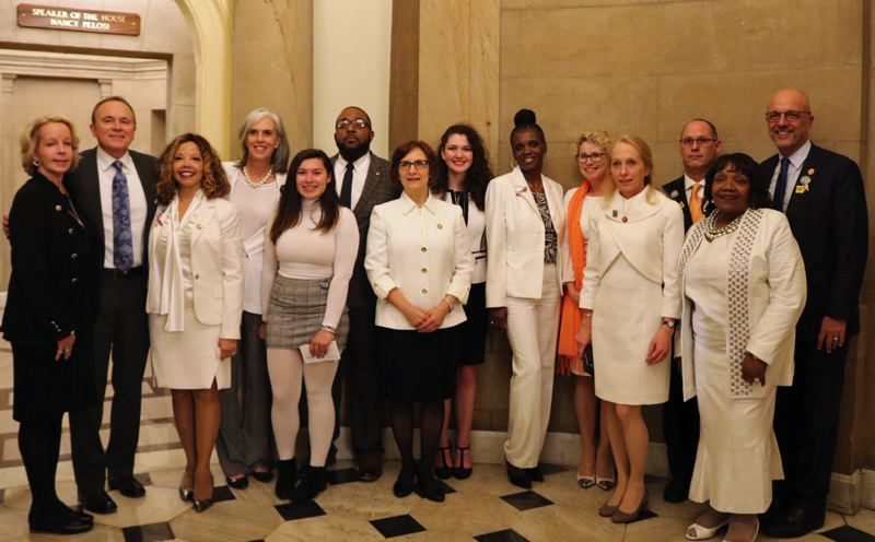 SUBMITTED PHOTO: NATALIE CROFTS - Members of Congress and guests gather outside the office of Speaker of the House Nancy Pelosi prior to the president's State of the Union speech. Many women in Congress wore white on Tuesday in honor of the suffragist movement, which led to the 19th amendment granted women the right to vote. Congresswoman Bonamici stands center with Goddard behind her.