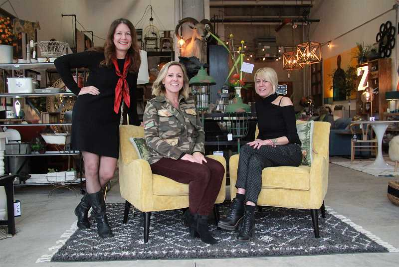 REVIEW PHOTO: SAM STITES - Owner Kim Pellet (from left) and employees Kristen Bean and Gigi Karnuth pose for a photo at the City Home pop-up shop in The Windward in Lake Oswego.
