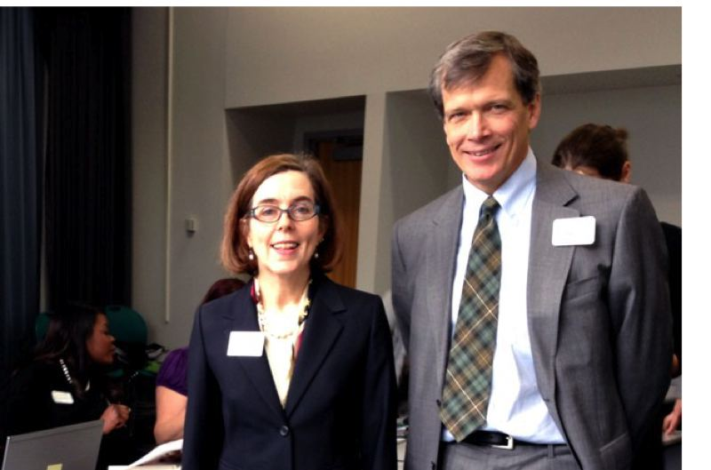 OREGON SECRETARY OF STATE FLICKR ACCOUNT - Bill Campbell, an executive with the Portland firm Equilibrium Capital, was among those whose emails with John Podesta were purloined by hackers determined by Special Counsel Robert Mueller to be Russian spies. Here, he is shown with then-Secretary of State Kate Brown in 2014.