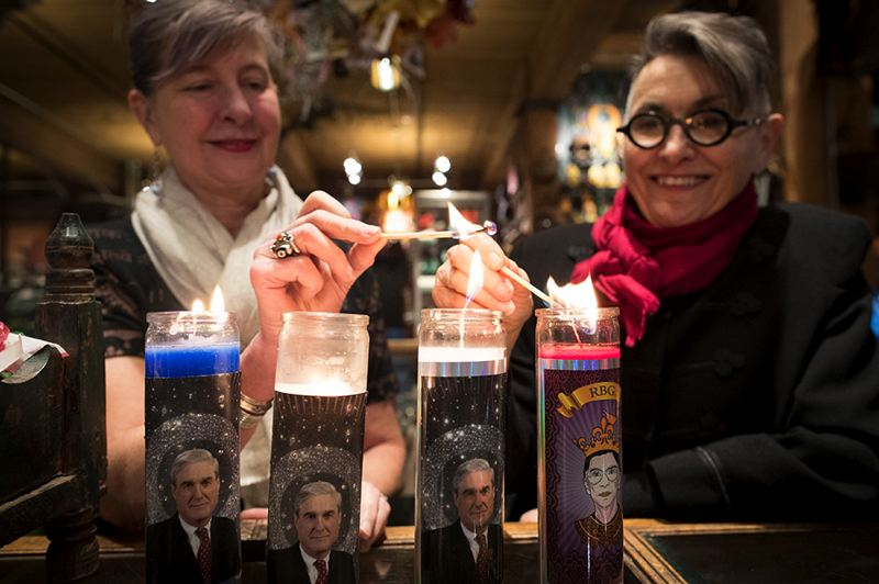 TRIBUNE PHOTO: JAIME VALDEZ - Bridgid Blackburn and Patty Merrill, co-owners of Cargo in Southeast Portland, provided an early market for an artist's idea of devotional candles featuring Special Counsel Robert Mueller. The idea has taken off and the store has told more than 2,000 so far, sending them all over the country.