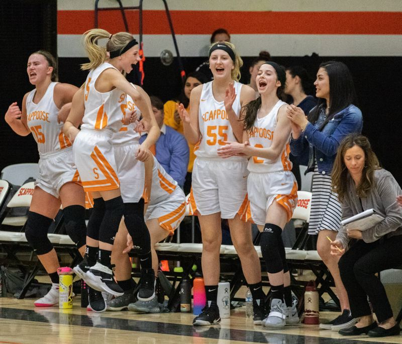 COURTESY: LOREN WOHLGEMUTH - The Scappoose bench gets excited as the horn sounds and the Indians celebrate their 37-30 girls basketball victory at home over St. Helens on Tuesday night.