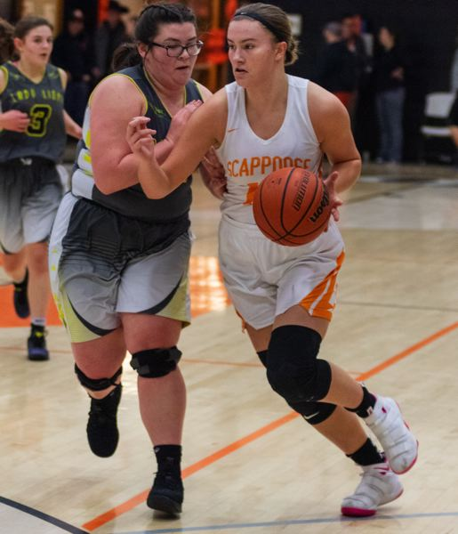 COURTESY: LOREN WOHLGEMUTH - Gaby Dague (right) of Scappoose tries to drive on St. Helens defender Madisyn Flores. Dague's 19 points led the Indians to their first league victory.