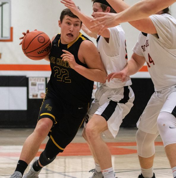 COURTESY: LOREN WOHLGEMUTH - St. Helens guard Canon Beisley sets his sights on going through the Scappoose defense during Tuesday's rivalry game won 52-50 by the visiting Lions.