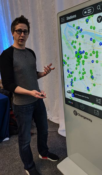 PMG PHOTO: JOSEPH GALLIVAN - Matt Teske, Founder and CEO of Charge- way, presenting his company's beacon product at the Portland International Auto Show in January 2019. It shows in simple colors and numbers where to charge an electric vehicle the quickest way.