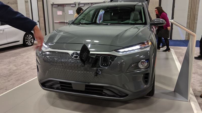 PMG PHOTO: JOSEPH GALLIVAN - It's a jungle out there as car makers put there charging ports in all kinds of places.