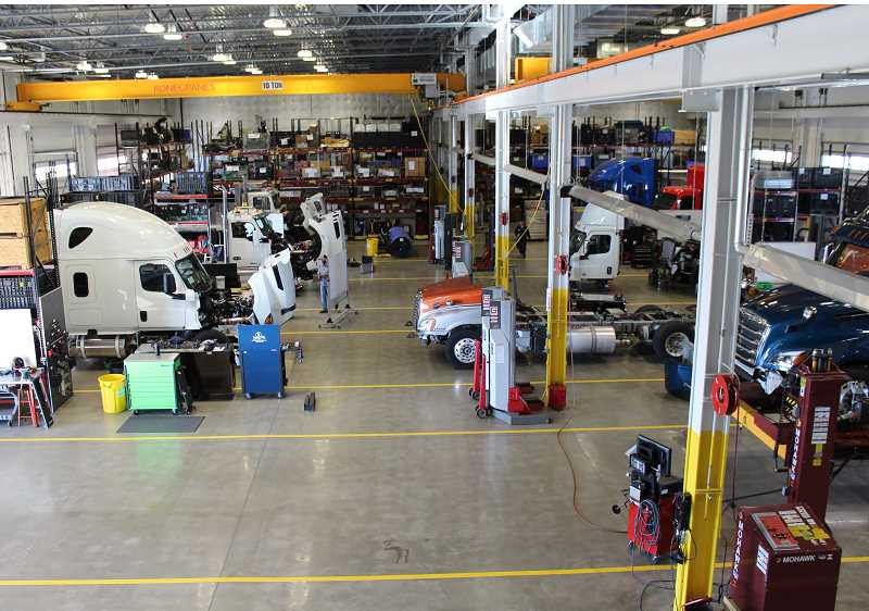 HOLLY M. GILL/MADRAS PIONEER - Inside the facility, there are numerous bays to allow staff to monitor and repair trucks.